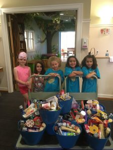 A Daisy Troop drops off cookies, cards and wish list items.