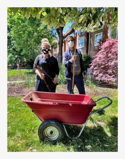 Janet and Mahmoud doing yardwork at RMH.jpg