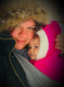 Julie and baby Logan bundled up in winter clothes outside