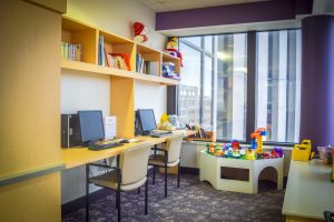 Kids play area and media center at the Family Room