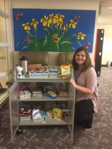 Snack cart and volunteer at the Family Room