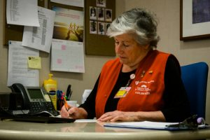 Volunteer Lucy Sims working at a desk