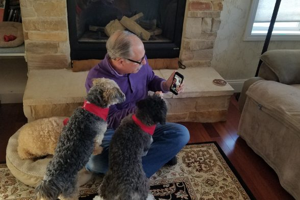 Glen Stout using facetime with his two dogs